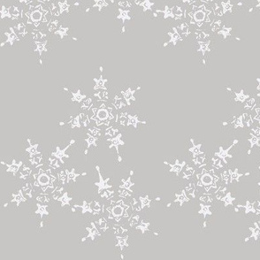 snowflake flurry on grey winter sky