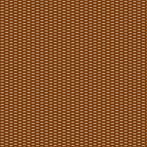 cream mustaches/ brown background