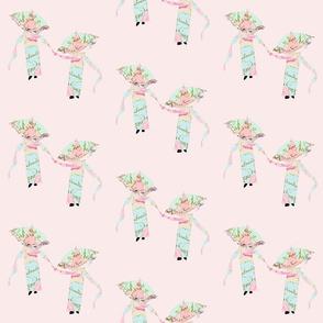 Kimonos parasols and scarves on pink