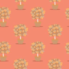 Lemon tree on pink background