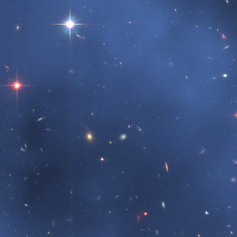 HD Hubble Finds Dark Matter Ring in Galaxy Cluster fabric ...