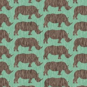 Rhinos on green linen