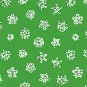 cut paper snow stars on green