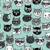 Cat Faces - Pale Turquoise by Andrea Lauren