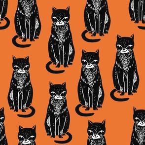 black cat // orange halloween cat stamp linocut cute kitty