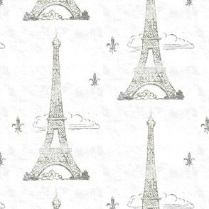 Silver shabby metallic Eiffel Tower in the clouds