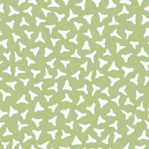 shark tooth silhouettes on pale green