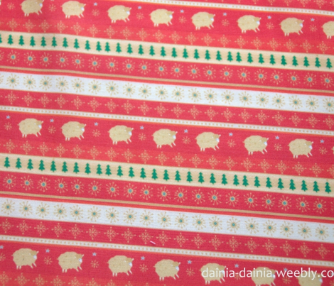 New year wrapping paper with golden lambs on red background