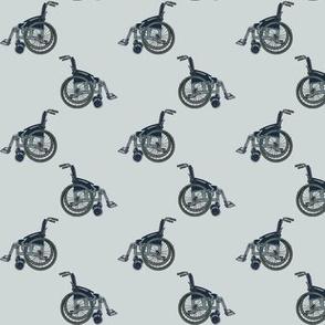 Wheelchairs on light grey