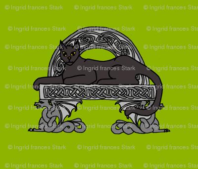 cat on a stone bench black
