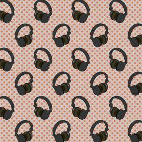 Headphones on orange dots