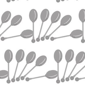 Tumbling silver spoons