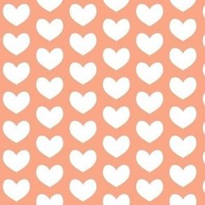 white heart on peach