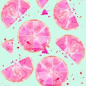 pink grapefruit on turquiose