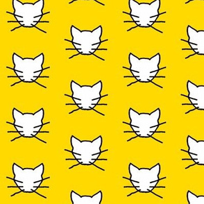 White cat on yellow