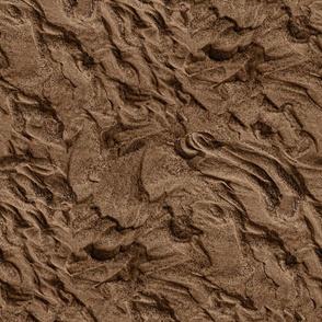 flowing sand, dark