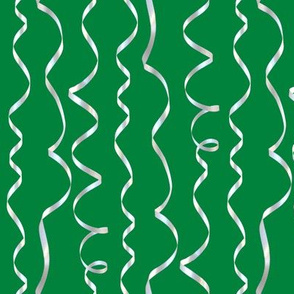 white curling ribbons on green