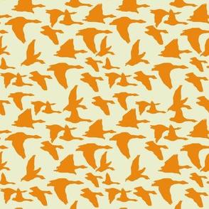 birds in flight orange and sage