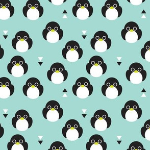 Adorable mint blue baby penguin birds with geometric detailing for kids