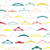 Colourful vintage coathangers on white