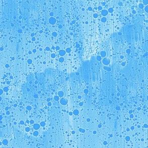 ink splatter in aqua