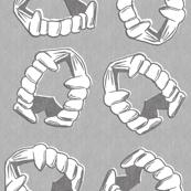 Plastic Vampire Teeth in stone