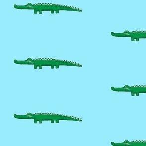 green crocodile with shadow, aqua background