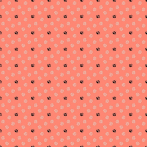 Trotting paw prints - white on coral with black