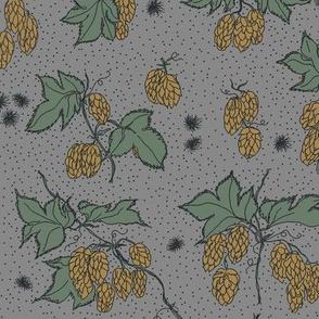 mustard hops and spiky burr on a grey bg