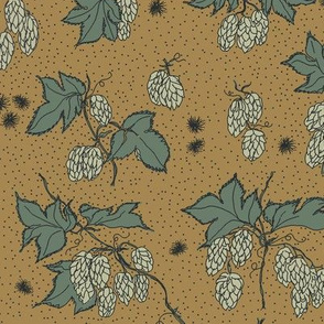 pale green hops and spiky burr on a mustard bg
