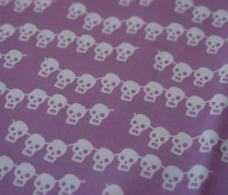 skeleton garland on pale purple