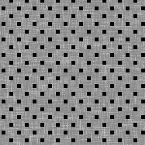 Black particles on gray linen-weave, a book cover by Su_G