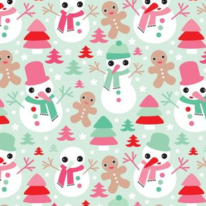 Colorful christmas theme with snowman and gingerbread man christmas trees and stars in mint and red