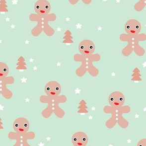 December happy holidays christmas theme kids gingerbread man and christmas trees and stars illustration in pastel mint