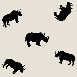 Rhino Silhouettes on Sand Background
