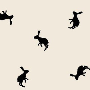 Rabbit Silhouettes on Sand Background