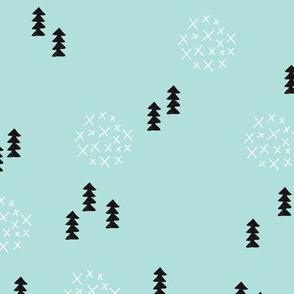 Scandinavian style christmas trees geometric woodland print in black and white and mint blue