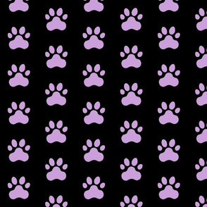 Pawprint Polka dots - 1 inch (2.54cm) - Pale Purple (#CB9FD9) on Black (#000000)