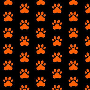 Pawprint Polka dots - 1 inch (2.54cm) - Mid Orange (#FF5F00) on Black (#000000)