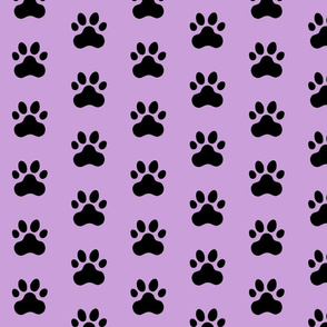 Pawprint Polka dots - 1 inch (2.54cm) - Black (#000000) on Pale Purple (#CB9FD9)