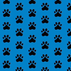 Pawprint Polka dots - 1 inch (2.54cm) - Black (#000000) on Light Blue (#0081C8)