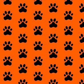 Pawprint Polka dots - 1 inch (2.54cm) - Black (#000000) on Mid Orange (#FF5F00)