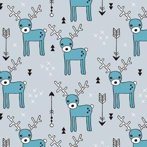 Adorable woodland reindeer and arrows christmas illustration kids pattern design in soft winter blue