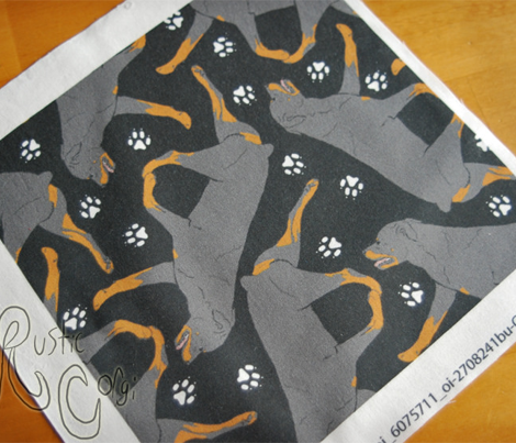 Trotting Rottweiler and paw prints - black