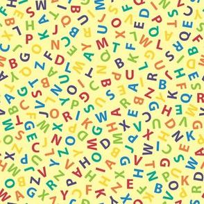 rainbow ditsy alphabet on pale gold