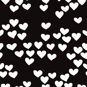 Pastel love hearts tossed hand drawn illustration pattern scandinavian style in neutral black and white