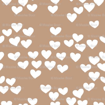 Pastel love hearts tossed hand drawn illustration pattern scandinavian style in soft ochre beige