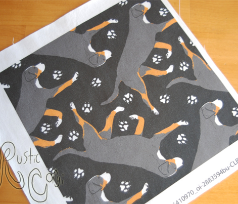 Trotting Greater Swiss Mountain Dog and paw prints - black