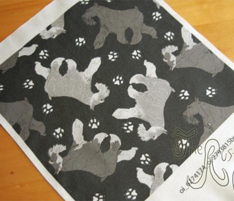 Trotting Miniature Schnauzers and paw prints - black