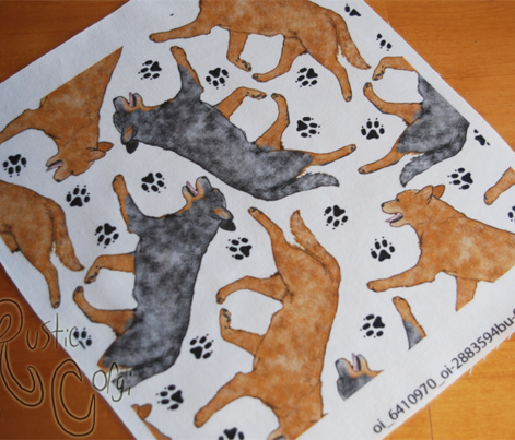 Trotting Australian Cattle Dogs and paw prints - white
